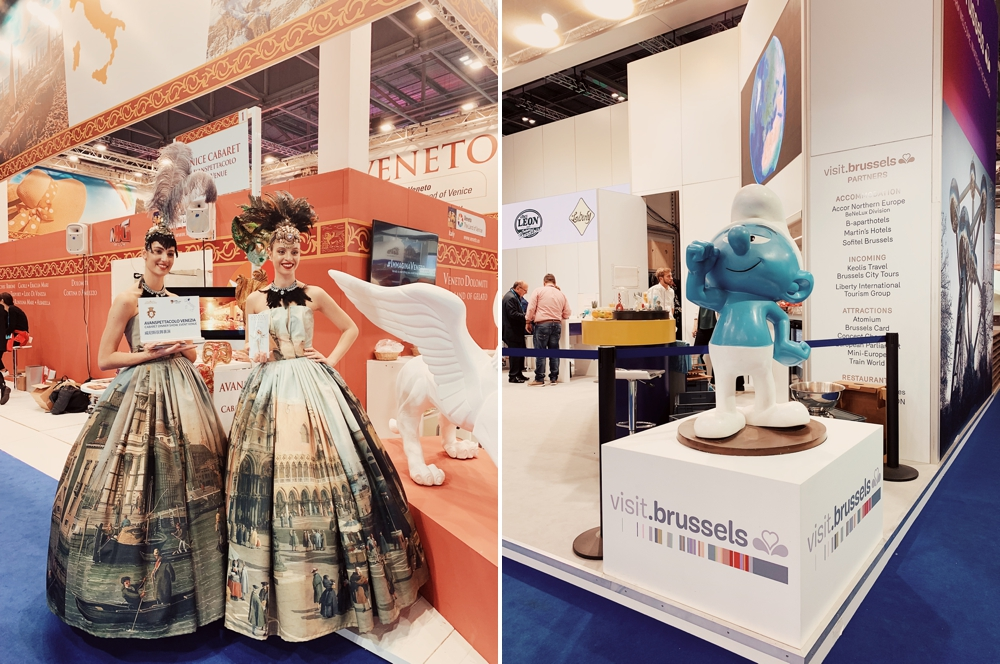 Two women wearing ball gowns decorated with scenes from Venice on the left. On the right A giant Smurf in the Brussels booth.